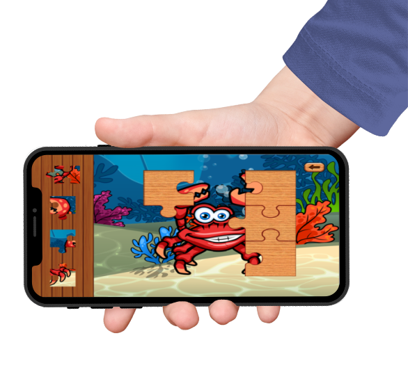 sea animal games puzzle featured on an iphone screen held by a hand with a blue sleeve